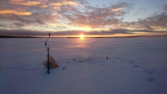 Icefishing on a lake